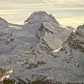 Yellow Airplane In Flight In Winter Swiss Alps