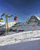 Cable Car Cabins On Winter Sport Resort In Swiss Alps