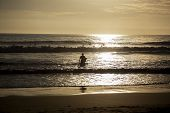 Surfer To Enter The Water At Sunset, Caparica Portugal