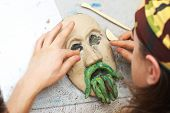 Sculpting Plasticine Form Of Face With Moustache
