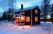 wooden house in Sweden during winter by night