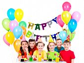 Group of happy children in colorful shirts having fun at the birthday party - isolated on a white.