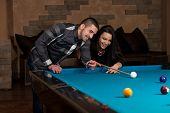Boy And Girl Flirting On A Pool Game