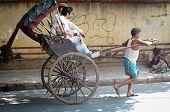 Rickshaw driver working in Kolkata, India.