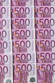 many of five hundred euro banknotes are adjacent. photo icon for wealth and investment