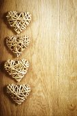 Four beautiful romantic vintage hearts on a wooden oak background. Love and St. Valentines Day concept.