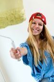 Young Beautiful Woman Painting Hew New Home.