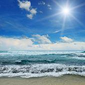 sun over sea and blue sky