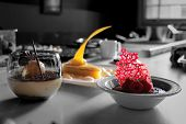 stock photo of pastry chef  - Award Winning Pastry Chef makes a trio of exquisite delights - JPG