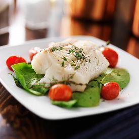stock photo of halibut  - halibut with spinach - JPG
