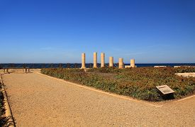 stock photo of promontory  - Column ruins of Herods promontory palace in Caesarea Maritima National Park - JPG