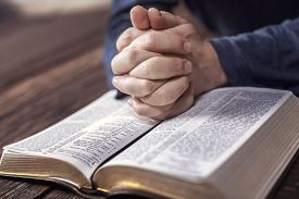 picture of hand god  - Man reading from the holy bible - JPG