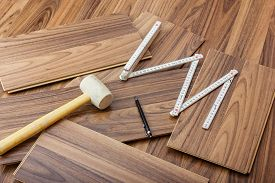picture of laminate  - Tools To Laying Laminate laying on the wooden laminate floor - JPG