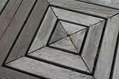 foto of parallelogram  - Weathered wooden square with pronounced grain and textured gray pattern set slightly askew - JPG