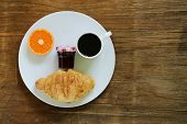 picture of croissant  - breakfast serving funny face on the plate  - JPG