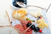 picture of salami  - cold cut assortment cheese salami and fresh pears served on a granite stone - JPG