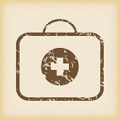 pic of first aid  - Grungy brown icon with image of first aid kit - JPG