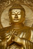 picture of siddhartha  - Close up of gold Budha statue in Peace Pagoda Battersea Park Wandsworth London UK - JPG