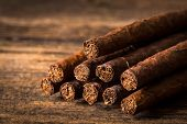 pic of cigar  - quality cigars for relaxing on an old wooden table - JPG