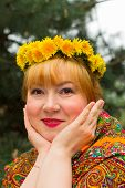 picture of flirty  - Cheeked Russian cheerful young woman in a wreath of fresh dandelion flirt flirty look - JPG
