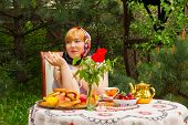 picture of curvaceous  - Beautiful Russian girl with a curvaceous rosy and happy sitting at a table with treats  - JPG