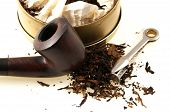 picture of tobacco-pipe  - pipe with round box of tobacco and accessories - JPG