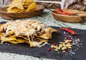 stock photo of nachos  - Nachos with beef beans tomatoes and cheese - JPG