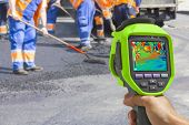 image of thermal  - Recording Workers on Asphalting and Repair of roads With Infrared Thermal Camera - JPG