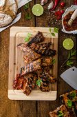 stock photo of baby back ribs  - Ribs in spicy marinade with chilli honey and beer - JPG