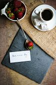 stock photo of middle eastern culture  - Cup of coffee eastern sweets and fresh strawberries on the old wooden table - JPG