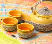 pic of ceremonial clothing  - Asian style tea set on a Vietnamese table cloth  - JPG