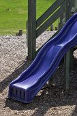 stock photo of recreate  - A small childrens slide is part of a recreational toyhouse located in a public park - JPG