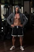 stock photo of hoodie  - Portrait Of A Physically Fit Man In Hoodie  - JPG