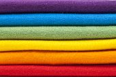 foto of t-shirt red  - A stack of colourful shirts in rainbow colours - JPG