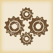 foto of four-wheel  - Grungy brown icon with image of four cogs - JPG