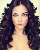 stock photo of big-bang  - Beautiful girl Fashion  model with long black  curled hair - JPG