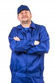 pic of overalls  - Worker in blue overalls. Isolated on a white background.