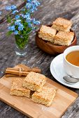 picture of eat me  - homemade sesame cookies with cup of tea - JPG