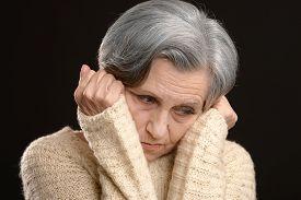 foto of thoughtfulness  - Portrait of a thoughtful sad elderly woman - JPG