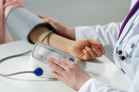 picture of measurement  - Female medicine doctor measuring blood pressure to patient - JPG