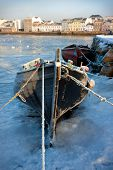 picture of claddagh  - boats covered by frost and ice on Corrib river in Claddagh Galway - JPG