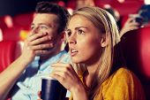 Постер, плакат: cinema entertainment and people concept couple drinking soda and watching horror drama or thrill