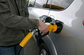 stock photo of bowser  - filling up with gas or petrol at the bowser - JPG