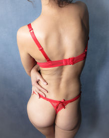 stock photo of exhibitionist  - Sexy young woman exposed in red lingerie - JPG