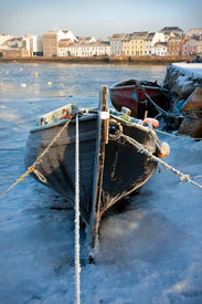 pic of claddagh  - boats covered by frost and ice on Corrib river in Claddagh Galway - JPG