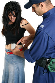 image of shoplifting  - a security guard removes a concealed shoplifted item from a criminal - JPG