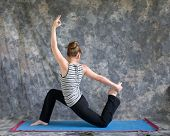 Woman Doing Yoga Posture King Arthurs Pose Variation