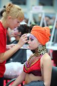 MOSCOW - OCTOBER 2: Visagiste makes makeup for model wear arab turban at XVII International Festival
