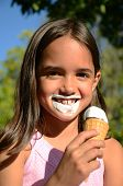 stock photo of ice cream cone  - Little girl is crazy for ice cream - JPG