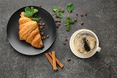 Composition with tasty croissant and coffee on grey background poster